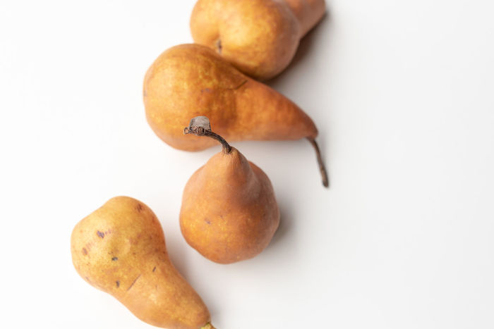 Beurré Bosc pears Brown Close-up Copy Space Cut Out Food Food And Drink Freshness Fruit Group Of Objects Healthy Eating Indoors  Medium Group Of Objects No People Orange Color Pear Snack Still Life Studio Shot Wellbeing White Background