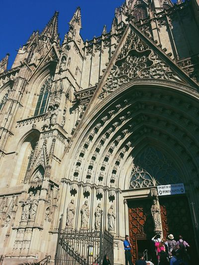 Barcelona Mágica Architecture Low Angle View Building Exterior Religion Place Of Worship Built Structure Travel Destinations Outdoors Cultures City Mobilephotography Mobile_photographer Vscocam History Barcelona Barcelona, Spain