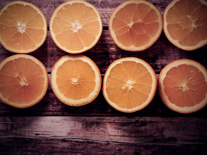 Citrus Fruit Healthy Eating Fruit Food And Drink Wellbeing Orange Color SLICE Orange - Fruit Orange Food Freshness Cross Section Wood - Material Close-up Indoors  Table No People Still Life Group Of Objects Juicy Sour Taste