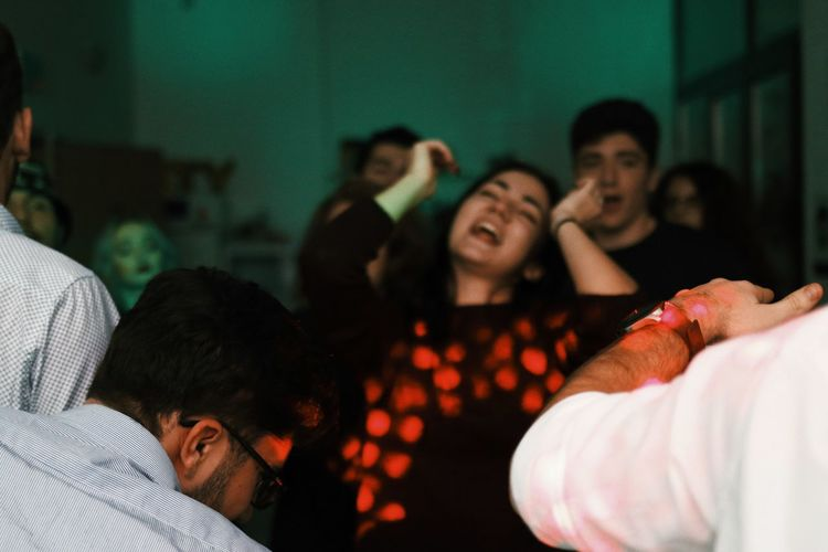 Friends dancing in party at home