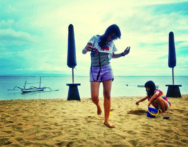 Playing and taking picture at the beach