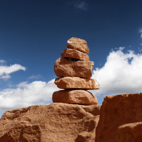 Signposts made of stacked stones from sandstone in the wadi rum nature reserve, jordan