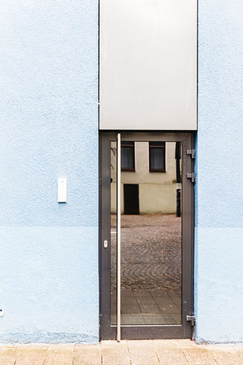 Architectural Column Architectural Feature Architecture Architecturelovers Blue Building Exterior Built Structure Closed Door Entrance Exterior Façade Geometric Architecture Geometric Shapes Grid House Mini Minimal Minimalism Minimalobsession Outdoors Reflection Reflections Shapes , Lines , Forms & Composition Shapes And Forms