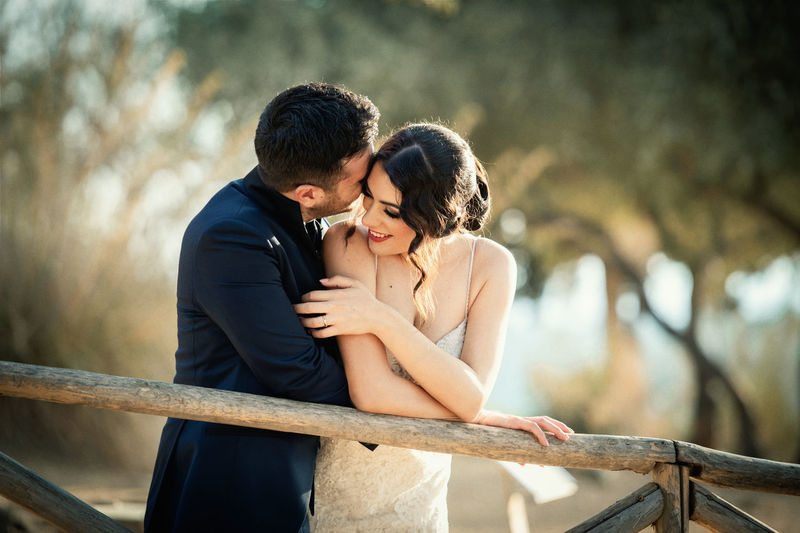 Adult Bonding Connection Couple - Relationship Embracing Emotion Focus On Foreground Heterosexual Couple Lifestyles Love Men Outdoors People Positive Emotion Railing Real People Togetherness Two People Women Young Adult Young Women
