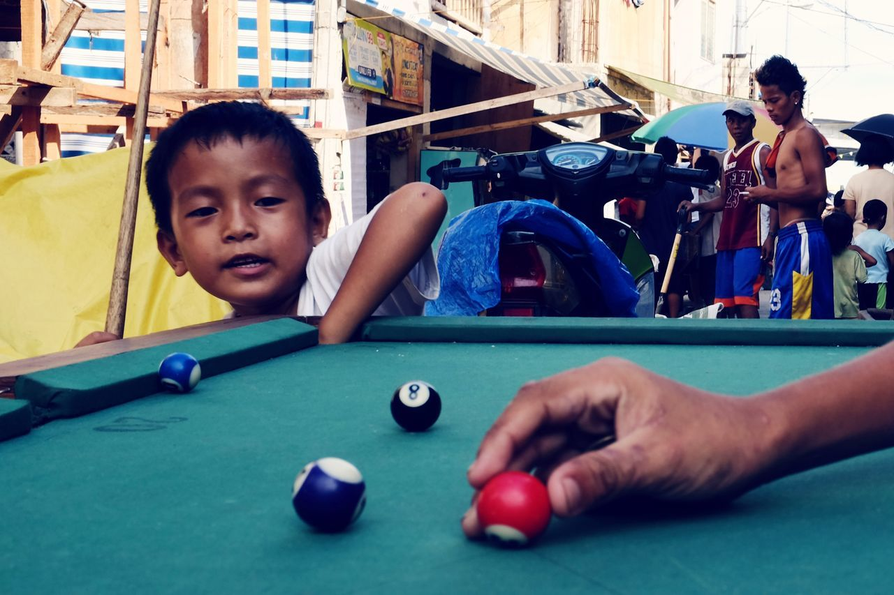 pool table, real people, pool ball, leisure activity, playing, pool - cue sport, indoors, two people, togetherness, pool cue, boys, young adult, sport, day, young women, human hand, snooker, people