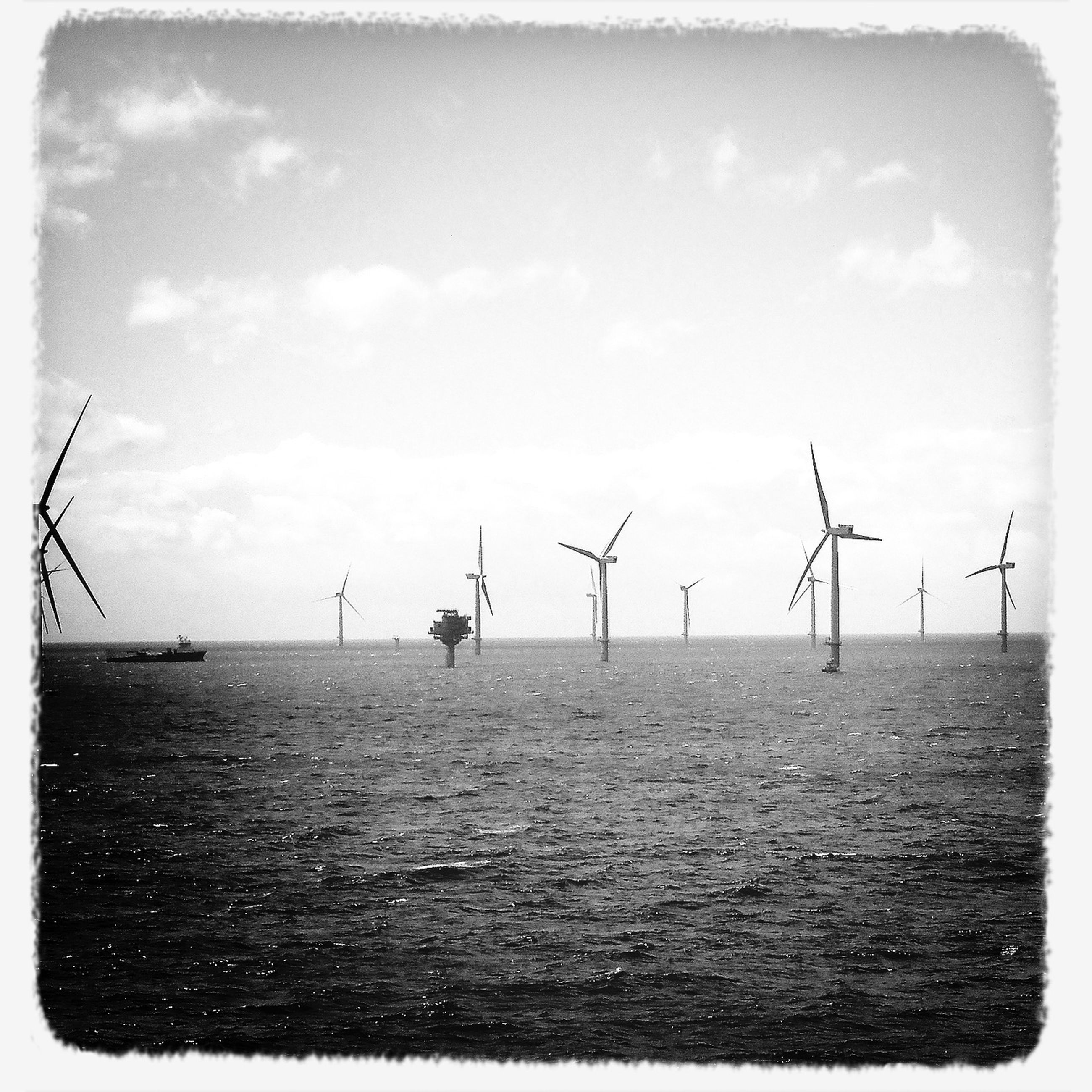 wind turbine, alternative energy, wind power, environmental conservation, windmill, renewable energy, fuel and power generation, transfer print, sky, auto post production filter, sea, water, traditional windmill, technology, tranquil scene, nature, tranquility, cloud - sky, day, outdoors