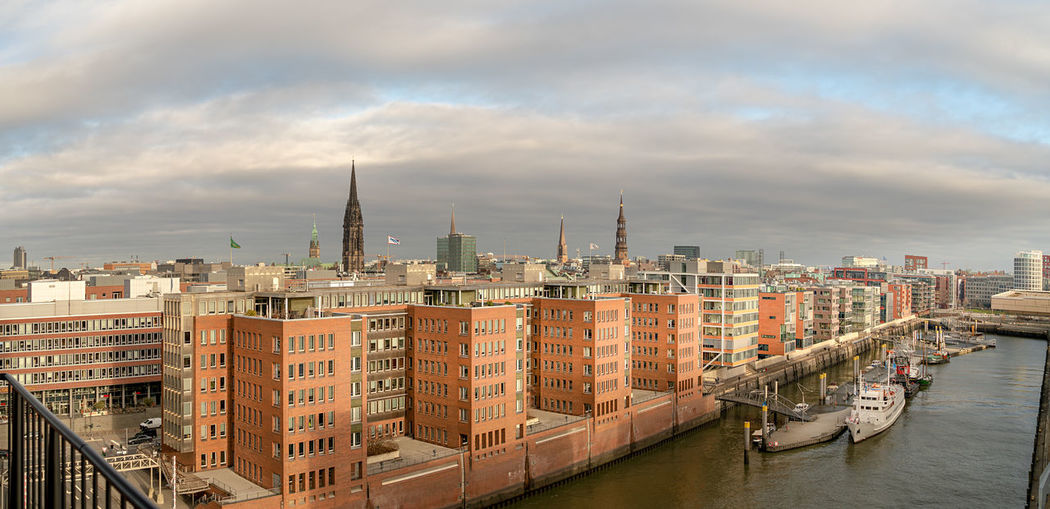 High angle view of buildings by canal against sky