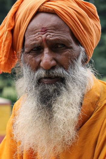 wrinkles India Sage Wrinkles Old Culture The Portraitist - 2018 EyeEm Awards Portrait Water Headshot Human Face Men Beard Front View Mid Adult Close-up Turban Dreadlocks Indian Subcontinent Beggar Orange Color Indian Subcontinent Ethnicity