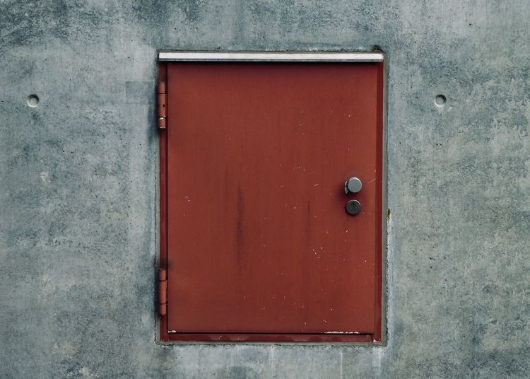 closed red door in concrete wall Copy Space Façade Textures and Surfaces Wall Architecture Backgrounds Building Exterior Close-up Closed Concept Concrete Door Entrance Gray Metal Metal Structure Minmalism No People Protection Red Safety Security Simplicity Textured  Wall - Building Feature #urbanana: The Urban Playground