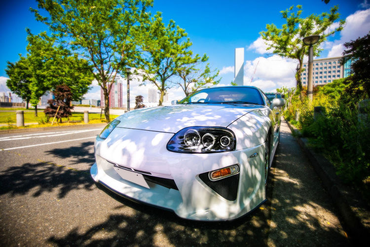夏色スポーツカー! Transportation Car Motor Vehicle Mode Of Transportation Tree Land Vehicle Plant Day Sunlight Nature City No People Road Sky Outdoors Focus On Foreground Blue Shadow Architecture Street Luxury Silver Colored