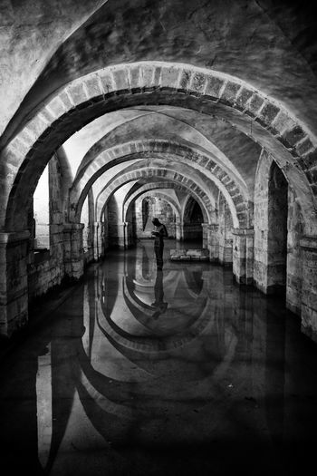 Crypted Arch Arch Bridge Arched Architectural Column Architecture Archway Black And White Building Built Structure Crypt Diminishing Perspective Hamshire History Indoors  Monochrome Railing Sony Rx100 Statue Tunnel Wall Water Winchester Winchester Cathedral