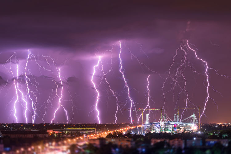 Lightning in dramatic sky over cityscape
