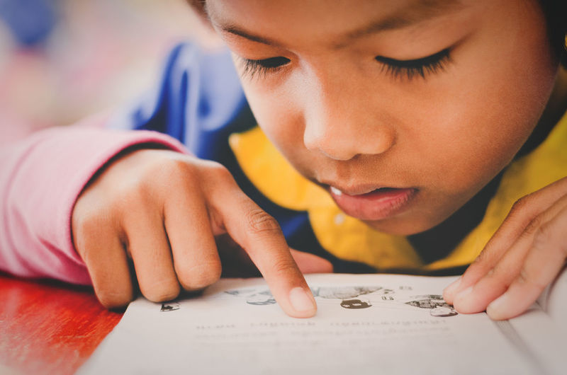 Child Childhood One Person Headshot Education Learning Portrait Indoors  Writing Concentration Offspring Close-up Looking Holding Table Innocence Studying School Supplies Girl Asain School