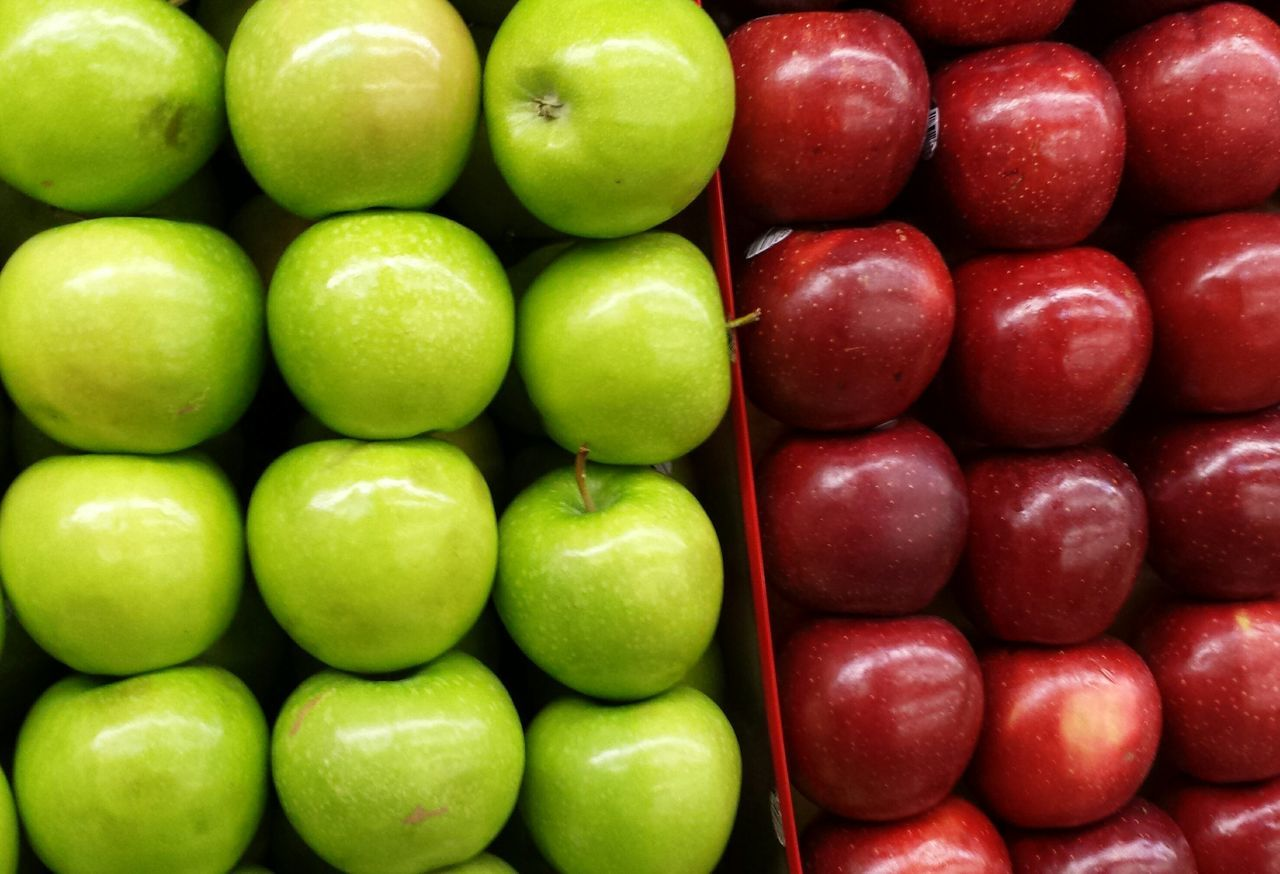 Full frame shot of green and red apple displayed for sale