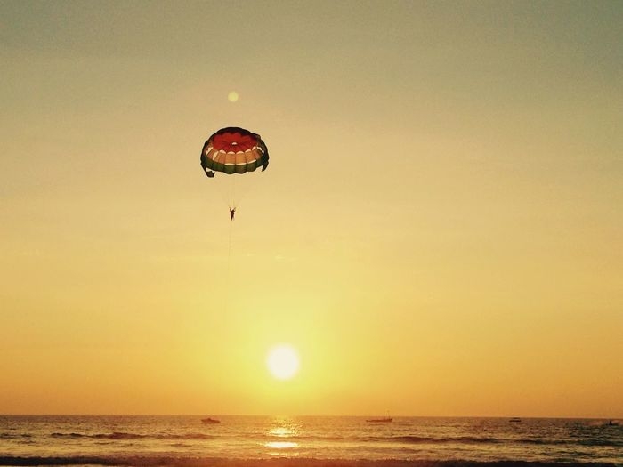 Person Parasailing Over Sea