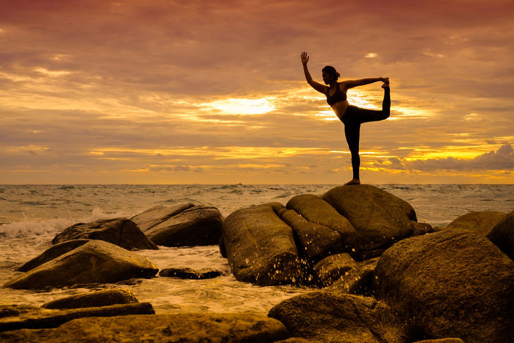 Yoga on the rock at the sunset with the murmur of waves Rock Wave Winter Yoga Beach Beauty In Nature Cloud - Sky Day Full Length Horizon Over Water Nature One Person Outdoors People Real People Rock - Object Scenics Sea Silhouette Sky Standing Sunset Tranquility Water Women