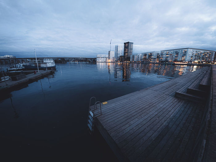 Modern apartment buildings by the waterfront in liljeholmskajen, stockholm, sweden