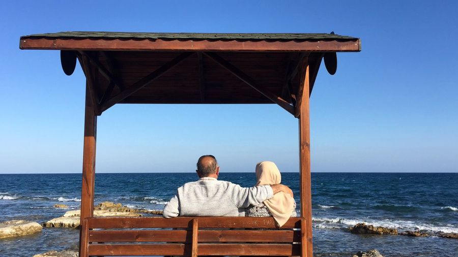 Grandpa & Grandma Old Relationships  Turkey Sea Beach Two People Relaxation Vacations Water Rear View Getting Away From It All Adults Only Horizon Over Water Tranquil Scene Togetherness Sitting Love Nature Couple - Relationship Women Men This Is Aging