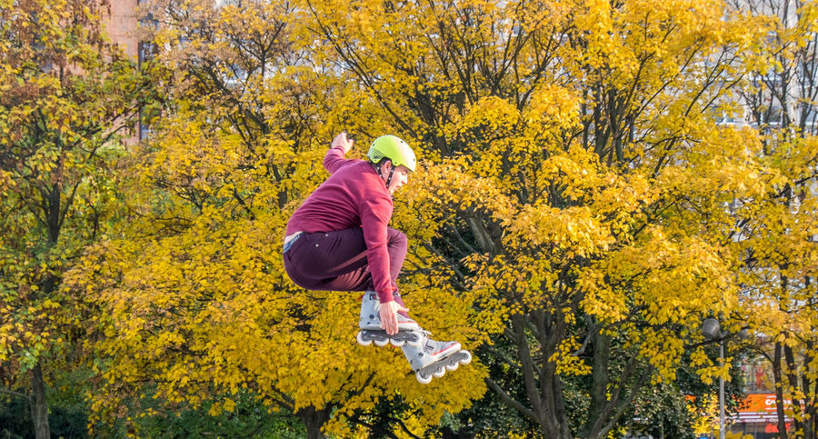 Action Autumn Flower Lifestyles Nature One Person Outdoors People Photo Photography Rollerblading Scenics Tree Trick