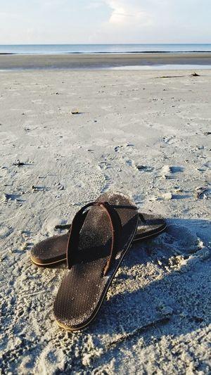 Flipflops Hilton Head Island, SC Neutral Colors Brown Shoes Beach Sand Shadow Sky Horizon Over Water Calm Ocean