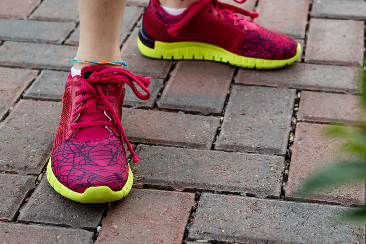 Body Part Day Fashion Footpath High Angle View Human Body Part Human Foot Human Leg Human Limb Lifestyles Low Section One Person Outdoors Paving Stone Real People Red Sandal Shoe Slipper  Sock Standing Street Women