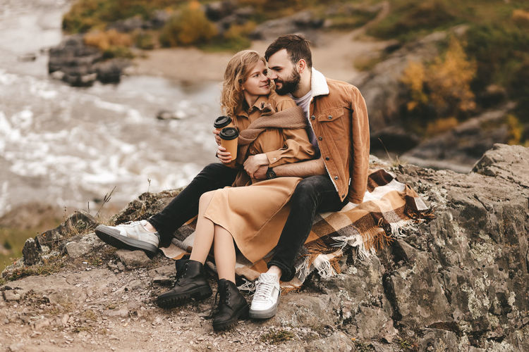 Young couple on rock