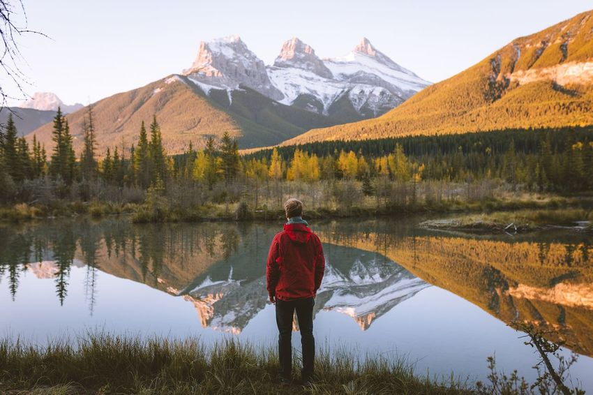 Watching the giants. Lake Mountain Mid Adult Reflection Nature Rear View One Person Beauty In Nature Hiking Adults Only Adult Mountain Range Scenics Backpack Water Adventure Lifestyles Outdoors Exploration Tranquil Scene Canada Alberta