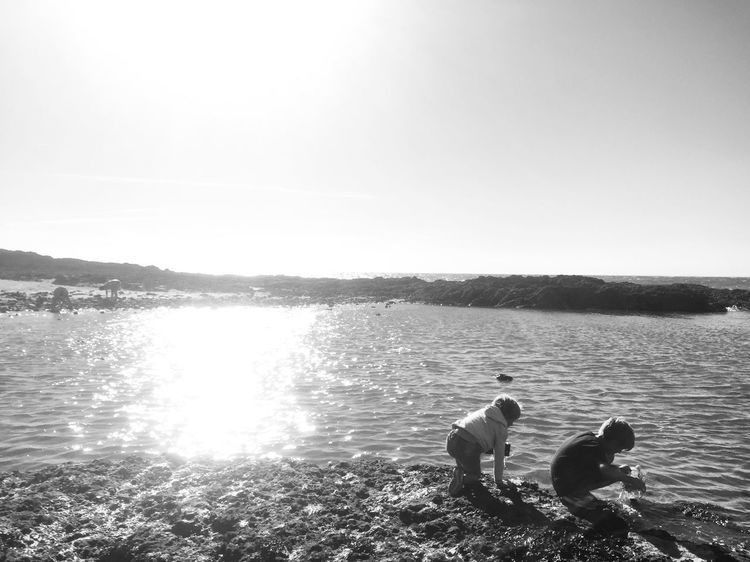 Water Togetherness Lake Nature Rippled Outdoors Tranquil Scene Two People Clear Sky Childhood Day Real People Bonding Scenics Beauty In Nature Sky Friendship Brotherhood Blackandwhite France Beach Life Is A Beach Black And White