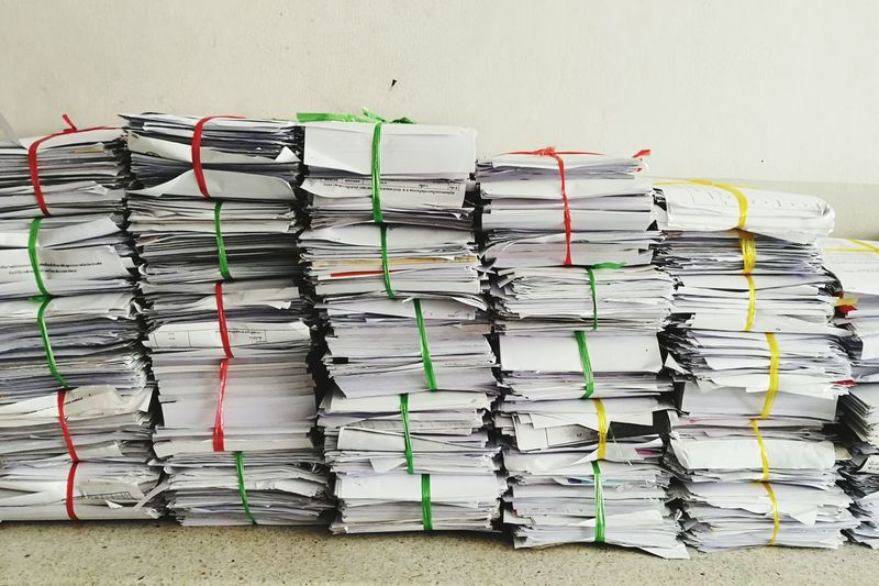 Stack of papers against wall