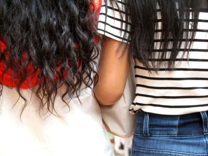 Girls Young Women Walking Togetherness Friendship Black Hair Arm In Arm