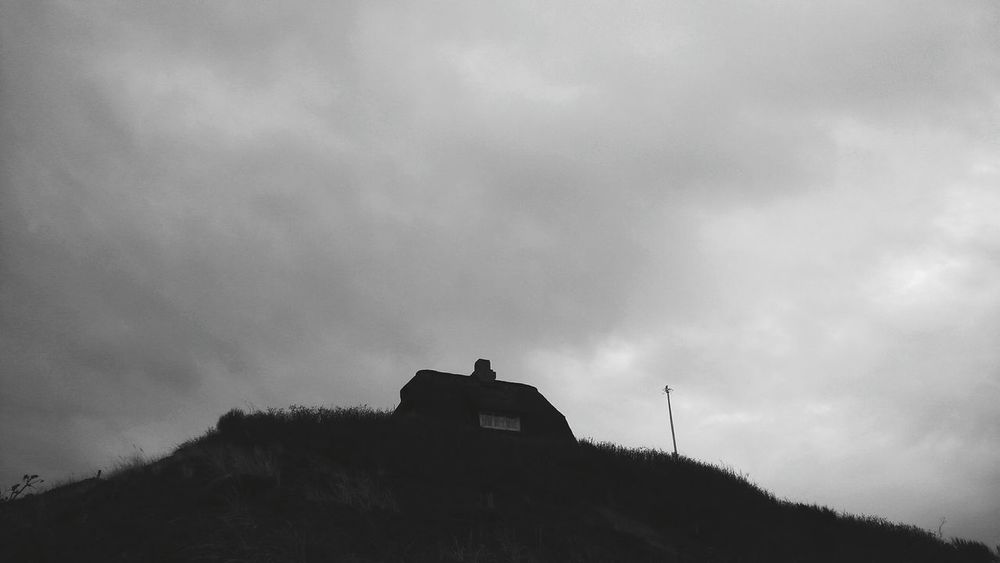 Entering Rantum. · Sylt Germany Island Building Reetdach Reetdachhaus On A Hill Silhouette Low Angle View Outdoors Cloudy Cloudy Sky Black And White Monochrome