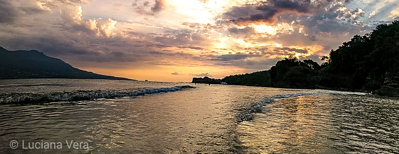 sky, sunset, cloud - sky, water, beauty in nature, scenics - nature, sea, tranquil scene, tranquility, beach, nature, land, no people, idyllic, mountain, non-urban scene, orange color, outdoors, sand