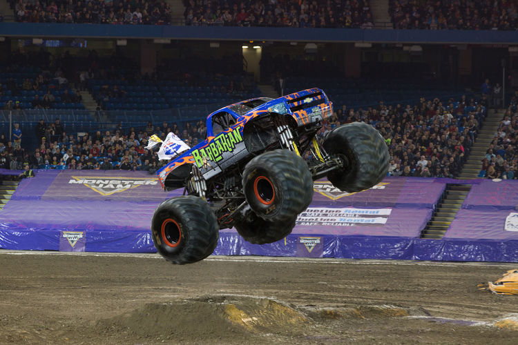 Jump Monster Jam Monster Trucks Audience Boxing Ring Competition Crowd Day Large Group Of People Mammal Men Outdoors People Performance Real People Sport Sports Race Sports Track Stadium Truck Trucks