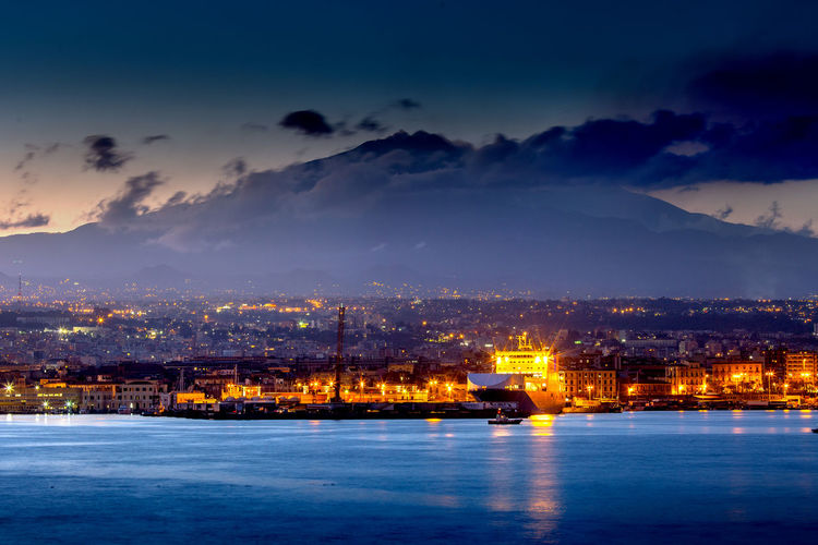 Catania and Mount Etna at dusk Cloud - Sky Sky Architecture Building Exterior City Night Illuminated Built Structure No People Water Nature Dusk Transportation Nautical Vessel Sea Cityscape Building Catania Catania, Sicily Sicily Etna Port