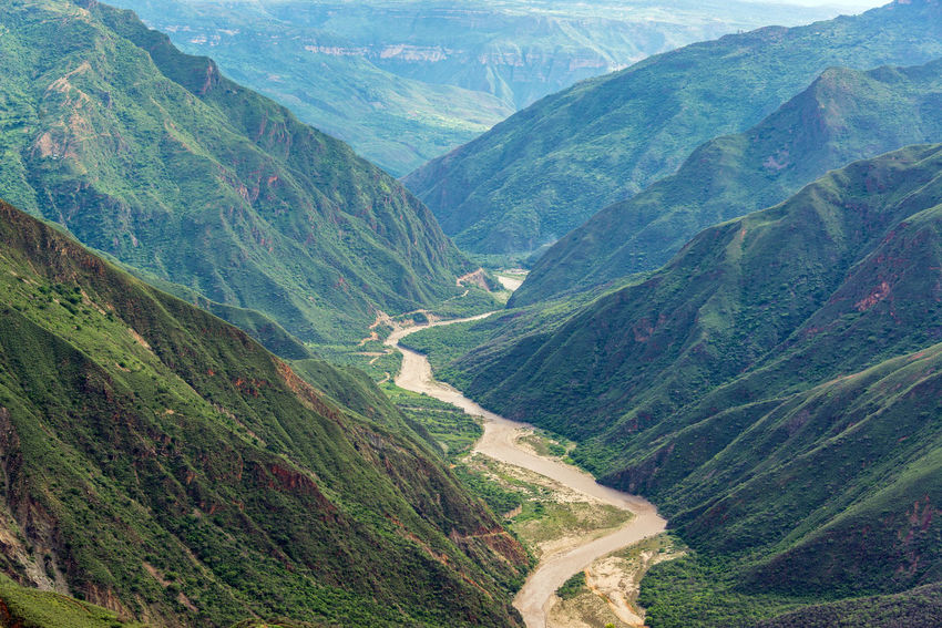 View of Chicamocha River meandering through Chicamocha Canyon near Bucaramanga, Colombia Chicamocha Canyon Cliffs Colombia Green Nature Panachi Santander Scenic Travel Tree Trees View Aerial Bucaramanga Canyon Chicamocha Landscape Mountain Mountains Outdoor Park River Tourism Vacation Wire