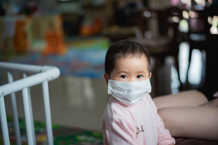 Portrait of baby girl wearing mask