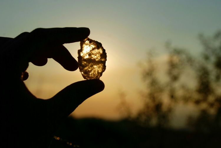 Glass stone Stone Sunset Mountain Horizon Summer Orange Macro Hand Human Body Part Silhouette Sunset Close-up Sky Growing Plant Life Gemstone  Tranquility Tranquil Scene Scenics