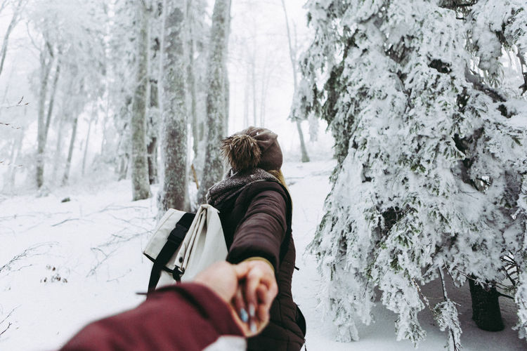 Adventure Beauty In Nature Cold Temperature Day EyeEm Nature Lover Eyem Best Shots Forest Hands Holding Human Body Part Human Hand Leisure Activity Lifestyles Men Nature One Person Outdoors People Real People Rear View Snow Tree Warm Clothing Winter Woman Connected By Travel