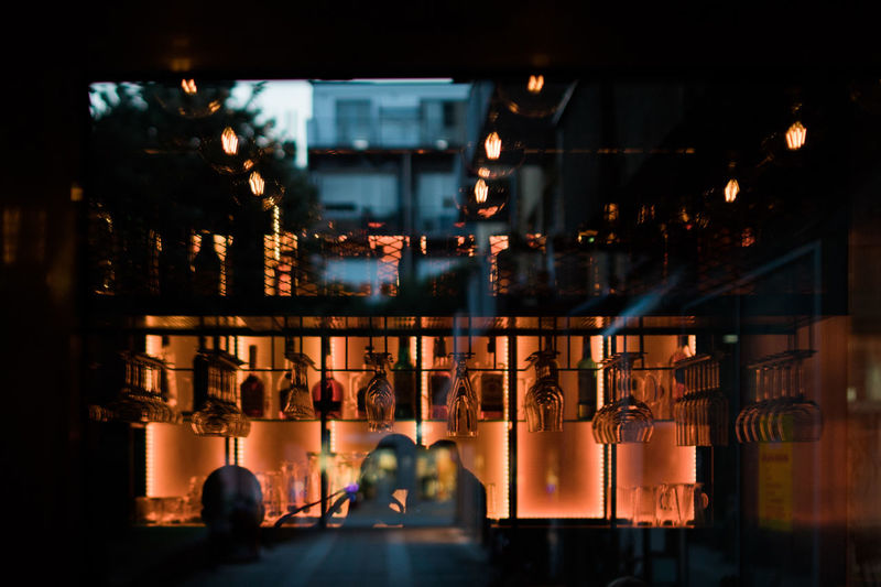 Architecture Bar Bar - Drink Establishment Bar Counter Bar Life Bar Lights Building Building Exterior Built Structure Business City Focus On Foreground Glass - Material Illuminated Incidental People Nature Night Nightlife Orange Color Outdoors Reflection Restaurant Window
