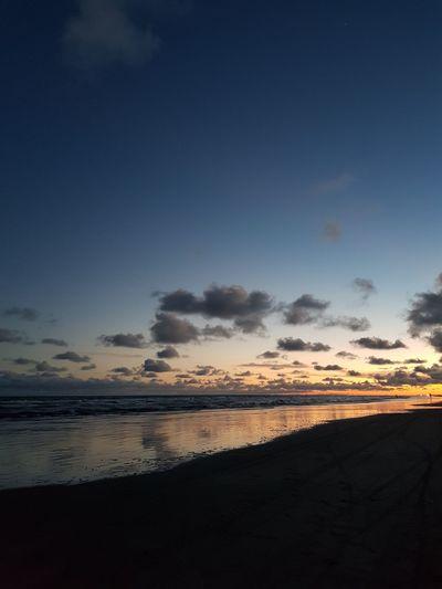 sunset on a beach Atardecer Mar Playa Water Sea Sunset Low Tide Beach Wave Sand Blue Sky Horizon Over Water Seascape Romantic Sky Dramatic Sky Sand Dune Calm Coast The Great Outdoors - 2018 EyeEm Awards