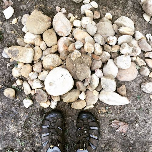 Rocks Feet Shoe Shoes Looking Down Down Low Section High Angle View Abundance Person Large Group Of Objects Personal Perspective Close-up Pebble Day In Front Of Outdoors Pebbles Pile Of Rocks Rock Pile Collection Outdoors Nature Beauty In Nature Feetselfie