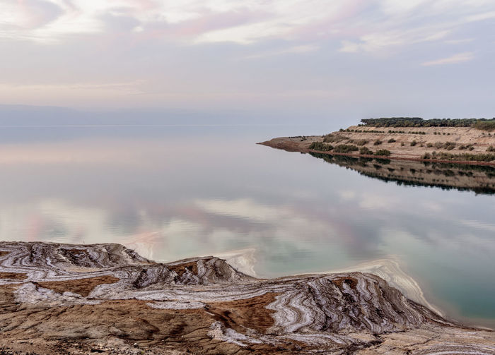 Dead Sea at dusk, elevated view, Karak Governorate, Jordan Geological Geology Formations Formation Rock Endorheic Hypersaline Salt Absence Silence Tranquility Tranquillity Tranquil Loneliness Isolation Iconic Landmark World Locations Tourist Attraction  Travel Destination Travel Destinations Geography Nightfall Dusk Twilight Evening Sundown Sunset High Angle View Elevated View Nature Shoreline Shore Coastal Coastline Coast Seascape Landscape Seas Sea East Bank ASIA Western Asia Middle Eastern Middle East Jordanian Jordan Lake Sea Of Salt Dead Sea