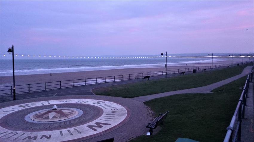 Dusk Sky File Filey Seafront Lights Promenade Wave Beach Beauty In Nature Day Dusk Grass Horizon Over Water Lights And Shades Nature No People Outdoors Railing Sand Scenics Sea Seaside Sky Tranquil Scene Tranquility Water