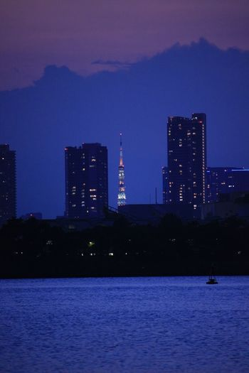Sea Japan Tokyo Tokyo Tower Architecture Building Exterior Built Structure Illuminated Night Skyscraper City Cityscape Modern Water No People Dusk Outdoors Sky Waterfront Sunset Urban Skyline Tall Travel Destinations