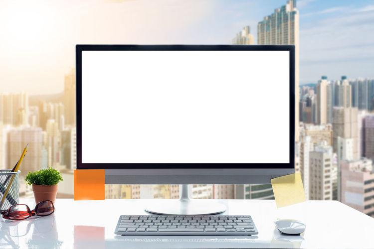 Close-Up Of Desktop Pc On Desk In Office