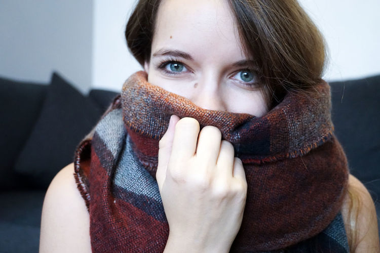 Young Women with Scarf Looking At Camera Portrait One Person Young Adult Headshot Front View Clothing Indoors  Covering Young Women Casual Clothing Scarf Human Face Adult Hands Covering Mouth Beautiful Woman Natural Model Girl Female Women Warm Clothing Autumn Winter Hand