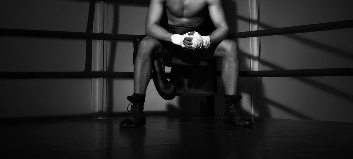 boxing Boxing Fight Photoshoot Active Adult Aggression  Body Part Boxing - Sport Boxing Glove Boxing Ring Dark Depression - Sadness Emotion Exercising Flooring Full Length Human Body Part Human Leg Indoors  Landscape Lifestyles Low Section Men One Person Sadness Sitting Sport Young Adult