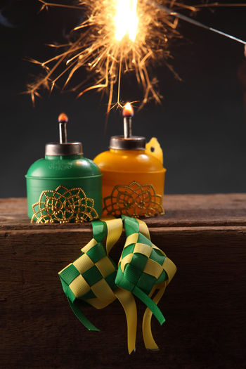 Close-up of candles with decoration on table