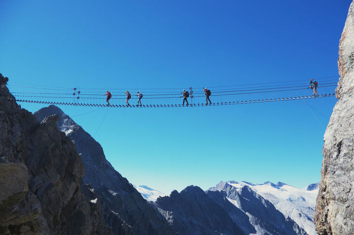 "The suspended bridge in the via ferrata ""Sentiero dei Fiori"". ADAMELLO-PRESANELLA ALPS, ITALY Adrenaline Climber Ponte Di Legno Summer Road Tripping The Great Outdoors - 2018 EyeEm Awards The Traveler - 2018 EyeEm Awards Adamello Adamello Brenta Alpinism Alps Castellaccio Ferrata  Hiking Adventures Mountain Range Mountains Outdoors Scenics - Nature Sentiero Dei Fiori Summer Sports Suspended Bridge Suspended In The Air Suspended Walkway Tonale Vertigo Via Ferrata"