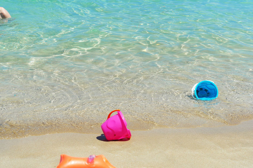 Children Toys Cyprus Protaras_Cyprus Beach Beauty In Nature Day Floating On Water Gold Beach High Angle View Nature No People Outdoors Pink Color Protaras Sand Sand Pail And Shovel Sea Water Chemistart
